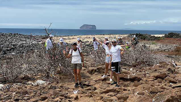 group of tourists walking on north seymour island